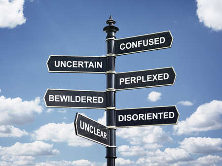 Photo pour Crossroad signpost saying confused, uncertain, perplexed, bewildered, disoriented, unclear concept for lost, confusion or decisions - image libre de droit