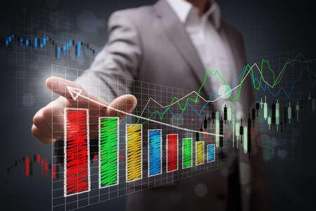 Foto de Businessman pointing to a growth chart showing business success - Imagen libre de derechos