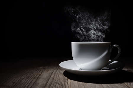 Photo pour Hot cup of coffee or tea with steam and copy space - image libre de droit