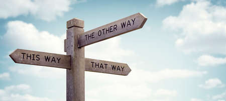 Foto de Crossroad signpost saying this way, that way, the other way concept for lost, confusion or decisions - Imagen libre de derechos