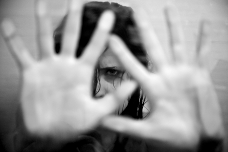 Photo for Sad woman scared putting hands in front of face - Royalty Free Image