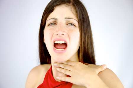 Photo for Sad woman feeling sick without voice - Royalty Free Image