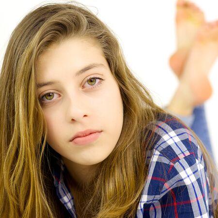 Photo pour Blond teenager looking camera serious - image libre de droit