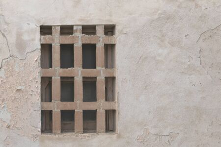 Foto de Bars cemented in front of window indicate need for security and protection - Imagen libre de derechos