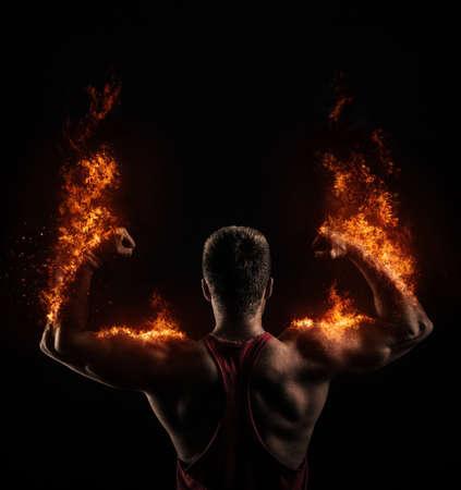 Foto de Strong Athletic man on fire - Imagen libre de derechos