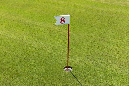 Photo pour hole in the Golf course with number. Playing Golf on the green grass - image libre de droit