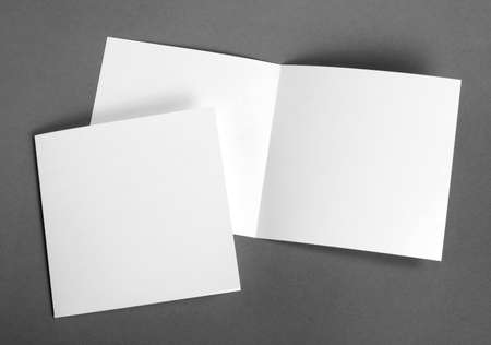Foto de White empty  cards on grey to replace your design - Imagen libre de derechos