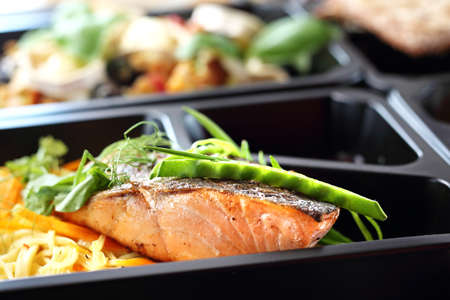Foto per Catering. Box diet. Takeaway food in a box. - Immagine Royalty Free