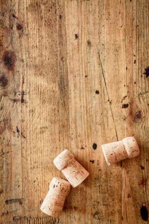 Foto de Bottle corks for champagne or wine on a wooden background with copyspace for your festive or New Year greeting - Imagen libre de derechos