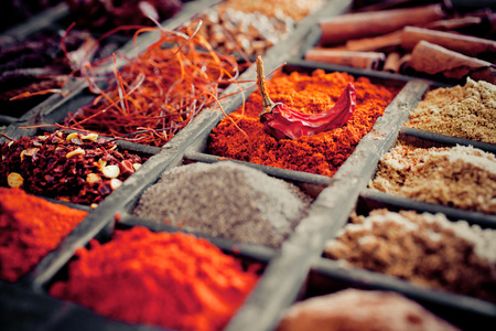 Photo pour Close-up of different types of Assorted Spices in a wooden box. - image libre de droit