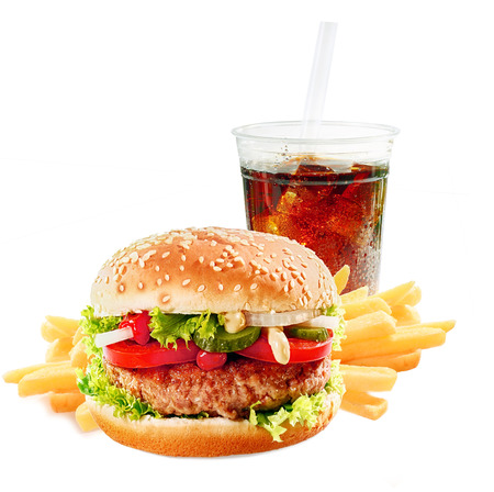 Photo pour Hamburger on a asesame bun with iced soda drink and crisp golden potato French fries on a white background - image libre de droit