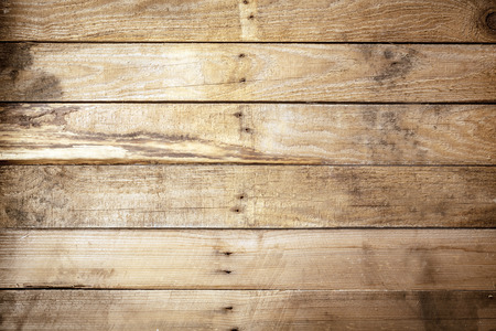 Photo pour Old weathered rustic wooden background texture with vintage brown wood boards with an uneven row of nails in the centre and stained woodgrain pattern, empty with copyspace - image libre de droit