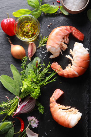 Foto de Yummy Shrimp Meat with Ingredients, Ready for Cooking, Isolated on Black Table Background - Imagen libre de derechos