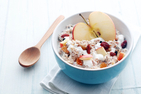Photo for Healthy bowl of muesli, apple, fruit, nuts and milk - Royalty Free Image