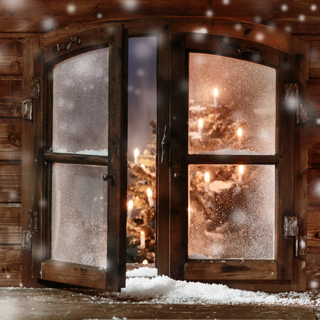 Photo for Close up Snow on Vintage Wooden Christmas Window Pane, Captured with Christmas Tree and Lights Inside. - Royalty Free Image