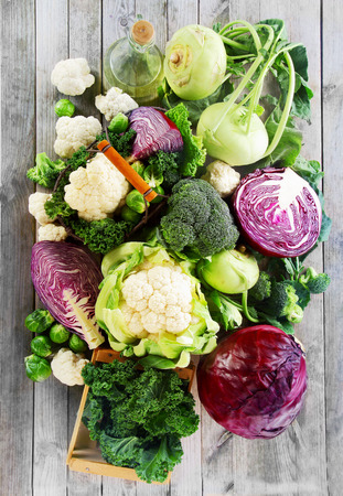 Photo pour Close up Assorted Healthy Fresh Vegetables on Wooden Table. Emphasizing Cabbage, Broccoli, Cauliflower and Brussels Sprout - image libre de droit