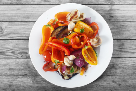 Foto de Close up Aerial Shot of Appetizing Healthy Recipe with Mushrooms and Spices on White Plate. Placed on Wooden Table. - Imagen libre de derechos