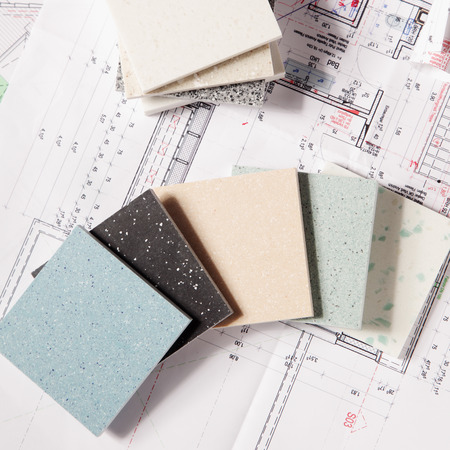 Photo pour Close up Different Choices of Tile Texture Designs for Housing on Top of a Printed Blueprint. - image libre de droit