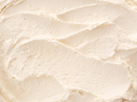 Photo for Delicious refreshing creamy Italian lemon or vanilla ice-cream for a summer dessert or takeaway, close up full frame background texture - Royalty Free Image