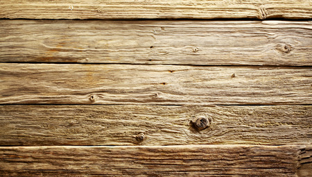 Foto de Old rustic rough textured weathered wood table or boards background viewed close up from above, full frame - Imagen libre de derechos