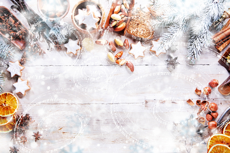 Photo pour White Christmas Background with empty copy space. Cakes and nuts as a decorative xmas frame for xmas concept or cards - image libre de droit