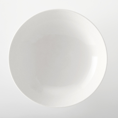 Foto de Empty plain white generic bowl viewed close up overhead with space for placement of food on a white background - Imagen libre de derechos