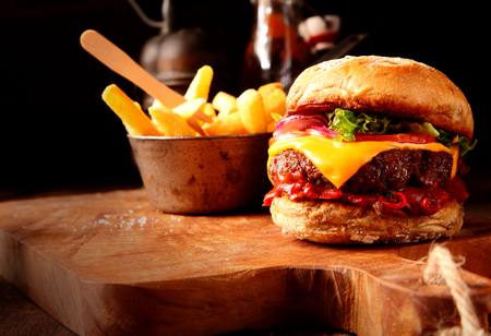 Photo pour Modern Fast Food homemade burger with chips or french fries for restaurant and menu cards - image libre de droit
