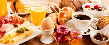 Photo for Breakfast feast with egg, meat, bread, coffee and juice - Royalty Free Image
