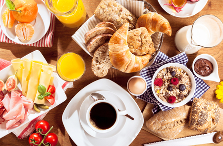 Photo for Top view of coffee, juice, fruit, bread and meat on table - Royalty Free Image