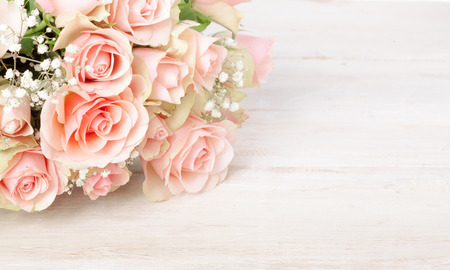 Photo for Delicate bouquet of fresh pink roses on a textured white wood background with copy space for your Valentines, Mothers Day, anniversary or birthday wishes - Royalty Free Image