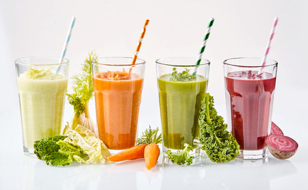 Photo for Fresh healthy vegetarian vegetable smoothies with fresh ingredients including cabbage, kale, carrots and beetroot for tasty drinks filled with vitality - Royalty Free Image