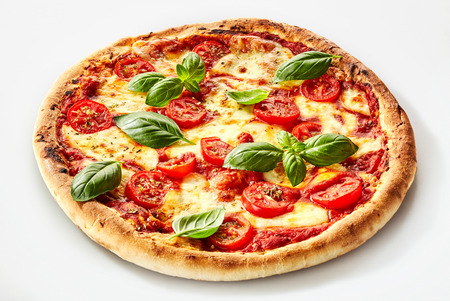 Photo for Flame grilled Margherita Italian pizza with fresh basil leaves on a thick biscuit base with mozzarella cheese and tomato - Royalty Free Image