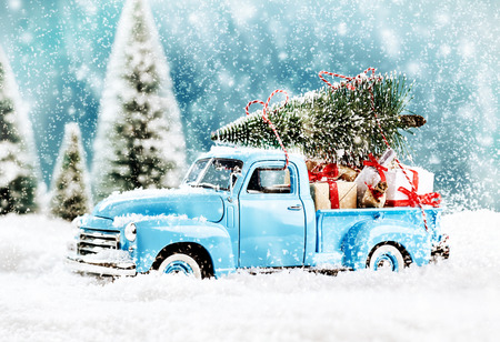 Photo pour Merry Christmas tree transporter bringing gifts to all the sweethearts on x mas evening - image libre de droit