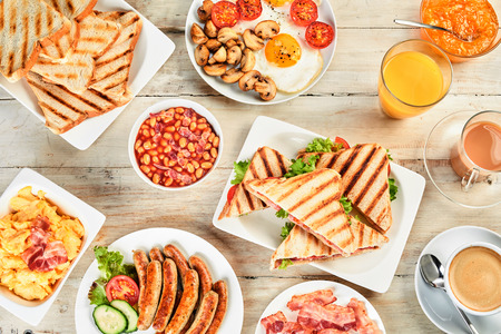 Photo for Overhead view of a table with english breakfast. Assortment of the english tradition of morning food. - Royalty Free Image