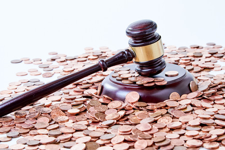 Photo for Wooden gavel and a pile of copper coins cropped closeup from high angle on white surface background, in concept of court corruption or successful auction sale deal - Royalty Free Image