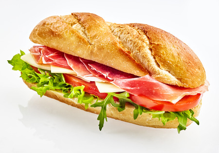Photo pour Fresh baguette sandwich with serrano ham , cheese, tomato and salad - image libre de droit