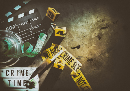 Photo for Circular film container and dirty metal knife next to yellow crime scene tape over brightly lit ground with shaded edges - Royalty Free Image