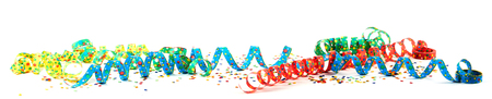 Foto de Colorful carnival ribbons with confetti against white background - Imagen libre de derechos