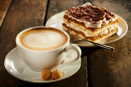Foto für Cup of double espresso coffee with piece of cake on wooden table - Lizenzfreies Bild