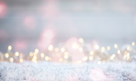 Photo for Ethereal soft Christmas background with a magical sparkling bokeh of party lights in a misty dreamy background over snow with copy space - Royalty Free Image