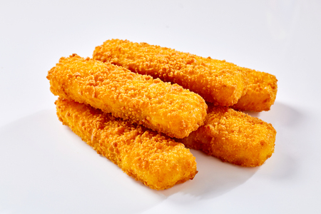Photo for Tasty crispy deep fried fish fingers lying against white background - Royalty Free Image