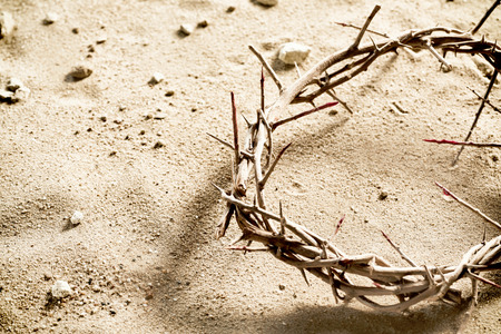 Photo pour Circlet or Crown of Thorns on barren sand with copy space in a spiritual concept of the crucifixion and Easter - image libre de droit