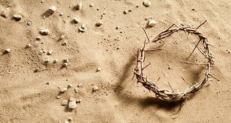 Photo for Crown of Thorns on stony sand conceptual of the crucifixion and Easter with copy space - Royalty Free Image