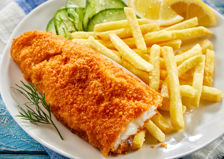 Photo for Portion of crispy fish with french fries served on plate - Royalty Free Image