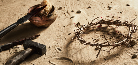 Photo pour Natural crown of thorns with bloody sponge, spear, old iron nails and a hammer lying on sand symbolic of the crucifixion of Christ and Easter - image libre de droit