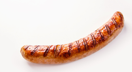 Photo pour Side view of curved single German bratwurst sausage on white background. - image libre de droit