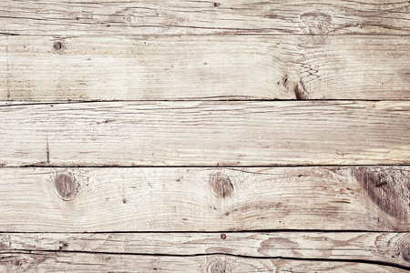 Foto de Old vintage faded natural wood background texture with cracks and knots in a full frame view - Imagen libre de derechos