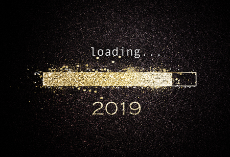 Foto per Computer screen with loading bar counting down for New Years Eve 2019 with sparkling glitter and copy space over black - Immagine Royalty Free