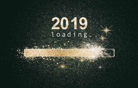 Photo for Glittering New Years background with a loading computer screen with sparkling gold bar and date over a black background - Royalty Free Image