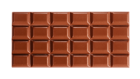 Foto de Close-up from above full-length view of an entire delicious milk chocolate tablet isolated on white for copy space - Imagen libre de derechos